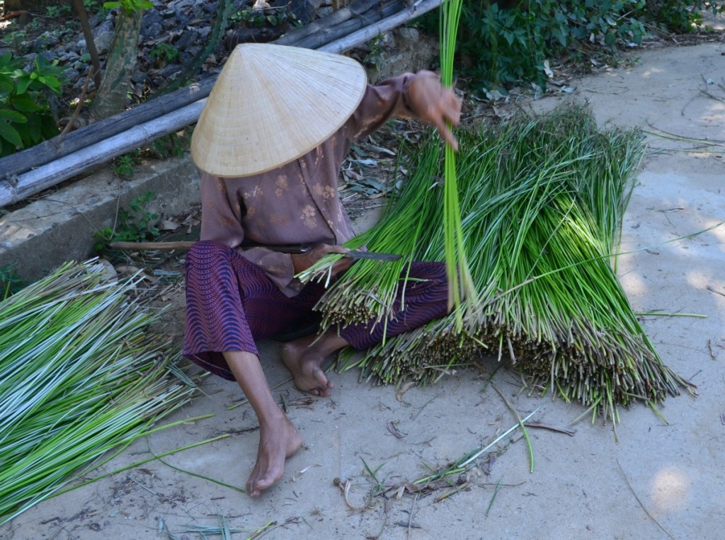 We came across lots of women splitting grass to make the colourful mats common around Hoi An