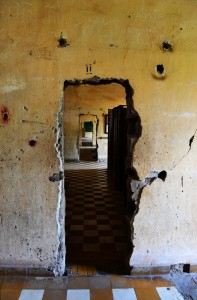 This is view through what used to be classrooms, but were used by the Khmer Rouge as individual holding cells for the civilians they arrested. The classrooms have been divided up into about 20 individual cells.