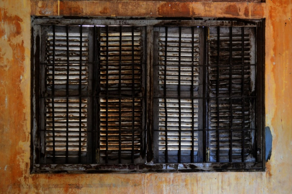 The windows in Tuol Sleng are barred and ugly.